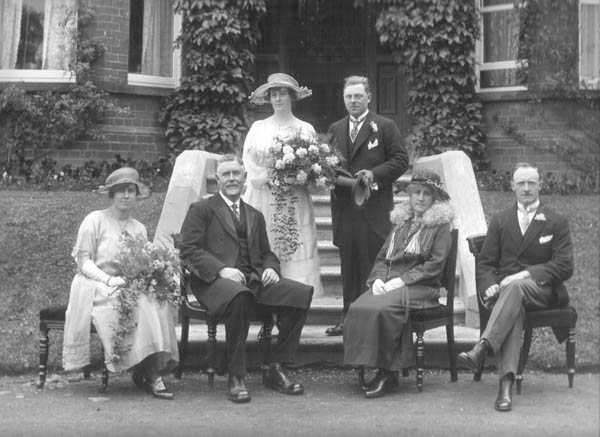 The marriage of Joshua (Joe) Hatrick to Miss Mary Roberta Morrow, wedding group with best man, bridesmaid and [probably] parents of the bride.