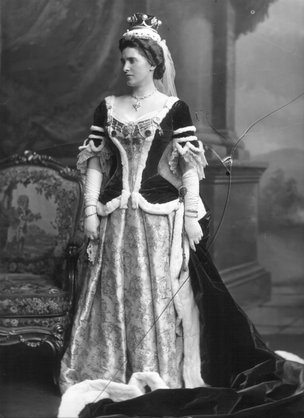 "copyright V&A. Isabella, Marchioness of Ailsa (d 1945), née MacMaster.  Coronation robes: ""...with bows of gold on the kirtle, over a skirt of gold and white brocade in an exquisite rocaille design"""