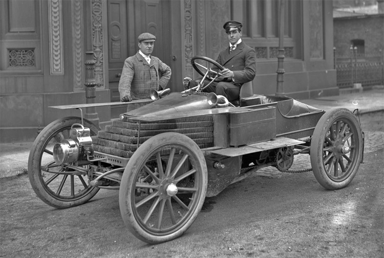 Lieutenant-Commander Montague Grahame-White (1877-1961), racing driver, car, yacht & aeroplane broker, at the wheel of a [4-cylinder, 30 h.p. or 45 h.p.] Wolseley racing car with actor Julius Knight (1863-1941).