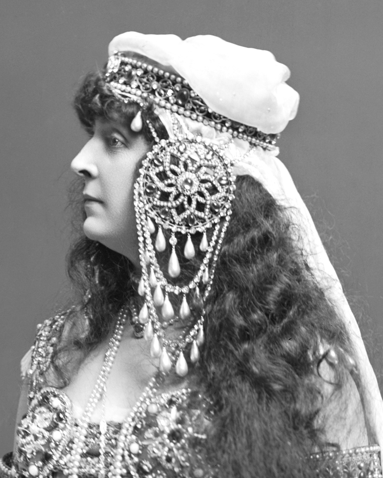 """...yellow chiffon with jewelled embroidery; a rose-coloured veil depending from an Oriental head-dress... sandals, and toe-rings on bare feet"" (The Ladies' Field, 30 May 1903, p 492b)., copyright V&A"