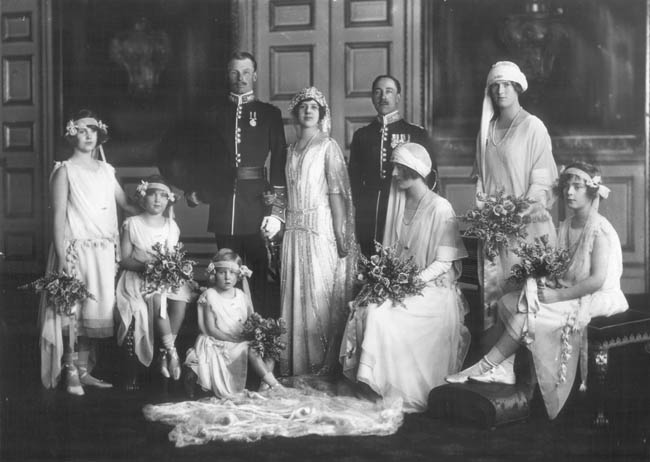 Group wedding portrait after the marriage of HH Princess Maud of Fife to Captain Lord Carnegie of the Scots Guards.